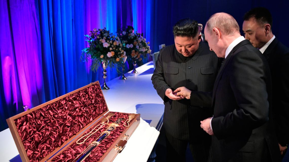 Russian President Vladimir Putin and North Korean leader Kim Jong Un exchange gifts following their talks at the Far Eastern Federal University campus on Russky island in the far-eastern Russian port of Vladivostok on April 25, 2019.