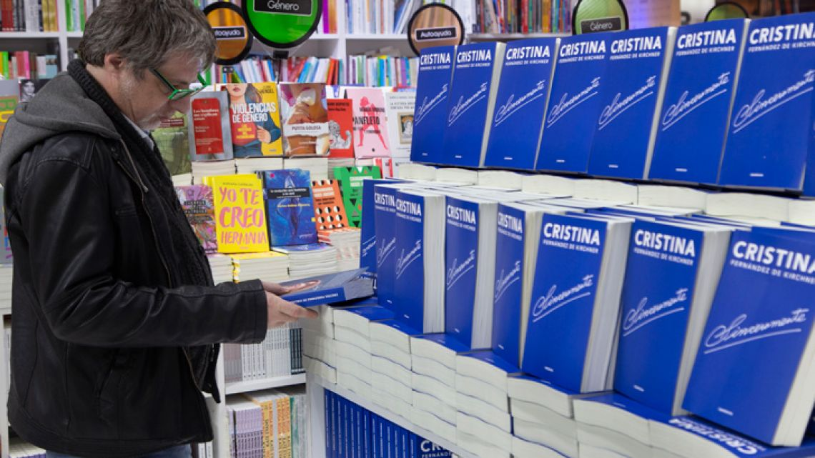 A reader picks up a copy of Cristina Fernández de Kirchner's book, Sinceramente, on the opening day of the45th edition of the Buenos Aires International Book Fair.