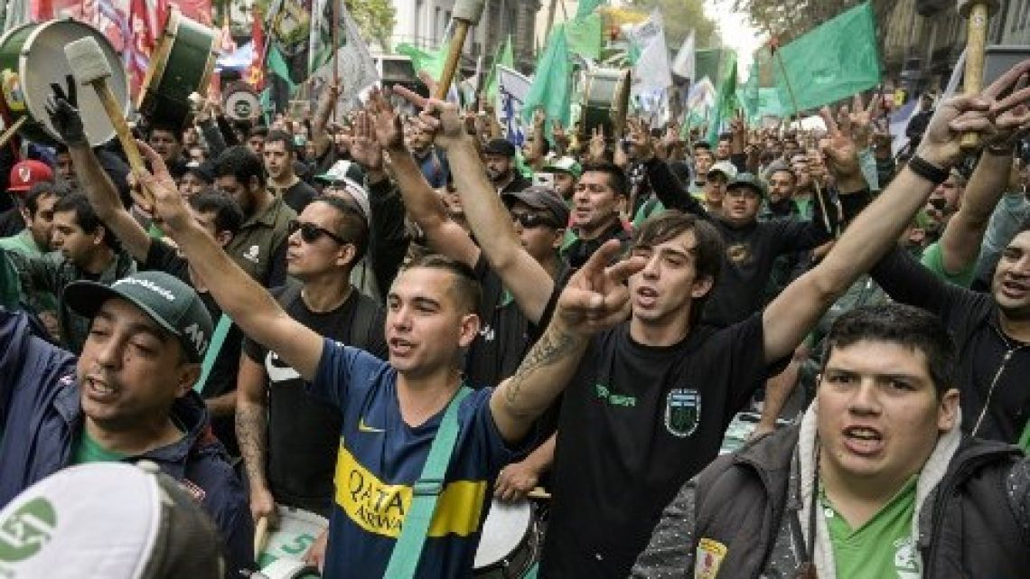 Members of the Mechanic and automotive transport Union (SMATA) sing the national anthem in a protest near Plaza de Mayo square during a partial strike against the economy policies of the government in Buenos Aires on April 30, 2019.
