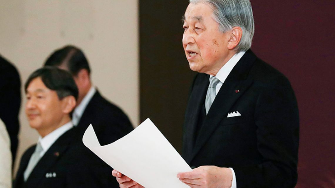 Japan's Emperor Akihito speaks during the ceremony of his abdication in front of other members of the royal families and top government officials at the Imperial Palace in Tokyo, Tuesday, April 30, 2019. The 85-year-old Akihito ends his three-decade reign on Tuesday as his son Crown Prince Naruhito, left, will ascend the Chrysanthemum throne on Wednesday.