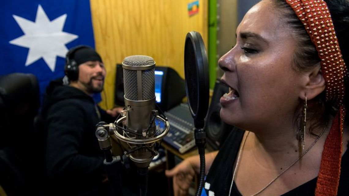 Filatraru Paillafilu (L) and Ana Millaleo, members of 'Wechekeche Ni Trawun' rap group, rehearse in Santiago on March 29, 2019.