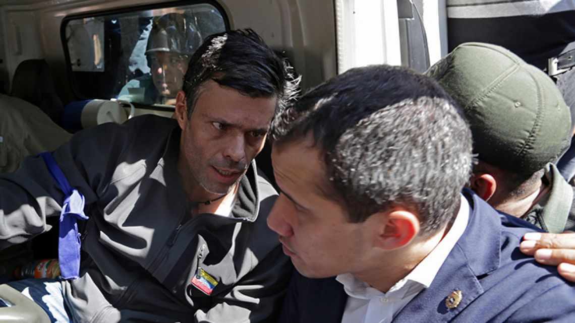 Venezuelan opposition leader and self-proclaimed acting president Juan Guaidó (right) and high-profile opposition politician Leopoldo López, who had been put under home arrest by Venezuelan President Nicolas Maduro's regime, chat inside a truck during a gathering with supporters and members of the Bolivarian National Guard who joined their campaign to oust Maduro, in Caracas on April 30, 2019.