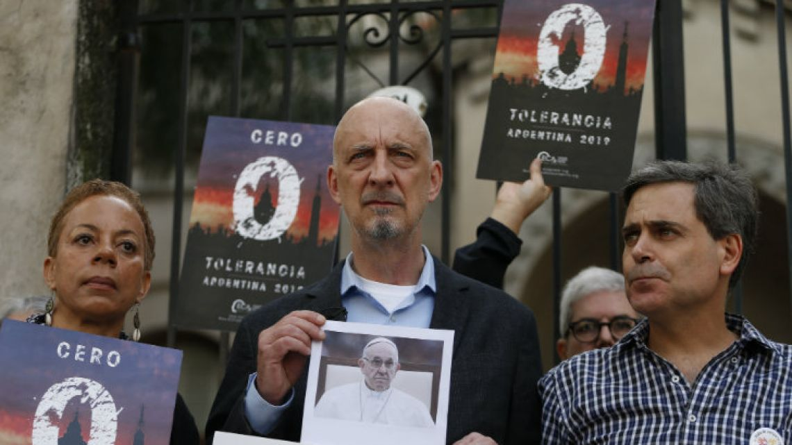 """Activists including Denise Buchanan (left) and Peter Isely (centre), stand with Sebastián Cuattromo, a victim of sexual abuse, outside a religious home in the capital this week, as they demand Pope Francis introduce """"zero tolerance"""" for those found guilty of committing abuse."""