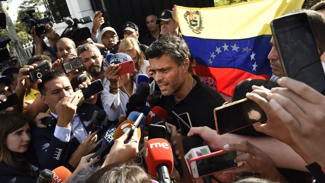 High-profile Venezuelan opposition politician Leopoldo López speaks with the press outside the Spanish Embassy in Caracas.