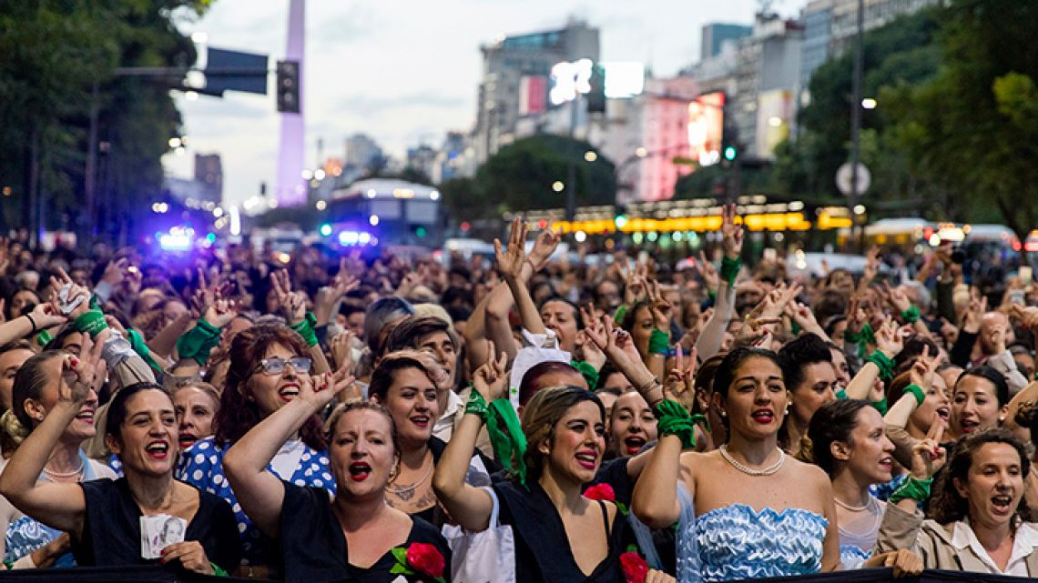 Women dressed as Eva Perón parade down the streets of the capital on Monday, to mark the 100th anniversary of her birth.