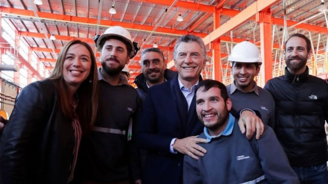 President Mauricio Macri (centre) and Governor of Buenos Aires province Maria Eugenia Vidal at a train repair workshop in Tolosa, near La Plata.