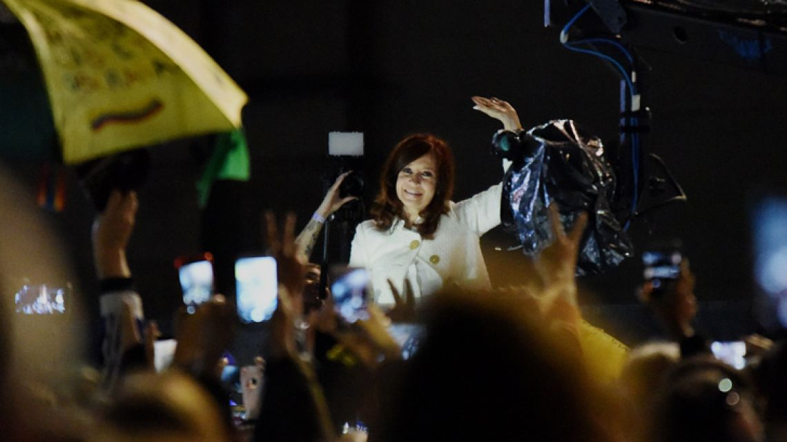Cristina Fernández de Kirchner waves to supporters outside the La Rural Convention Centre in Palermo, after presenting her book 'Sinceramente' at the Buenos Aires International Book Fair.