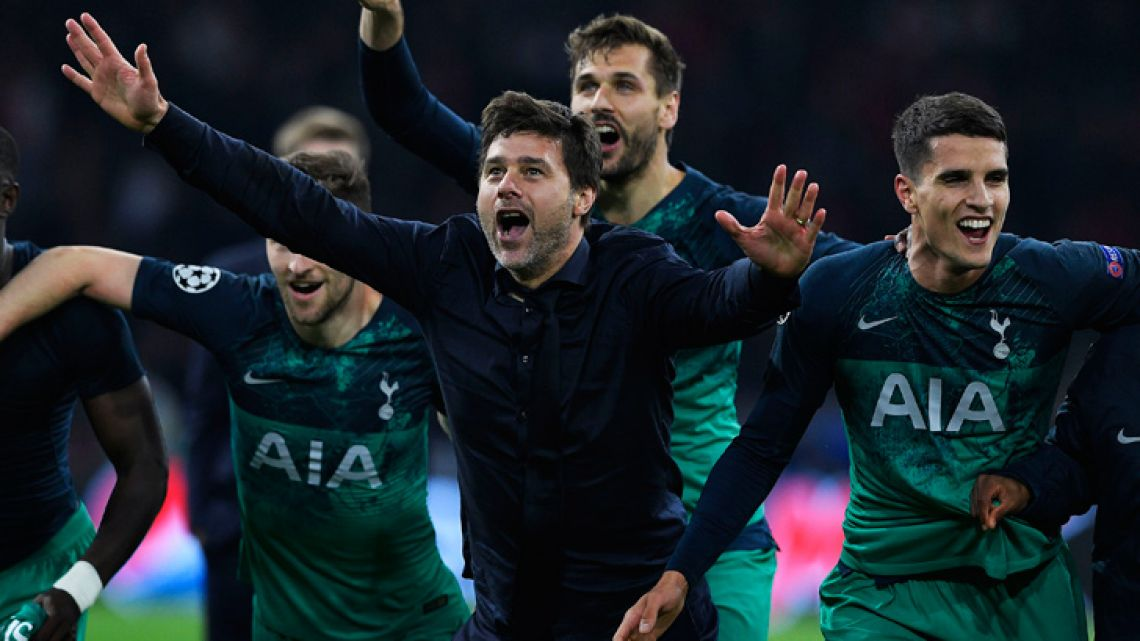 Tottenham Hotspur's Argentine coach Mauricio Pochettino (centre) and his players celebrate after winning the UEFA Champions League semi-final second leg aginst Ajax.
