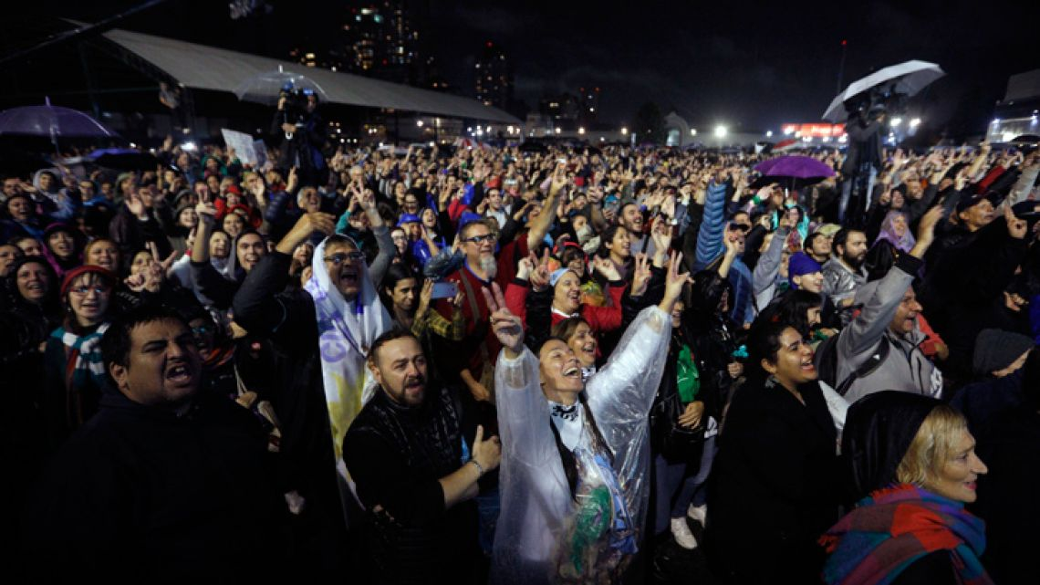 Supporters of Cristina Fernández de Kirchner cheer as she greets the crowd during the presentation of her new book at the 45th Buenos Aires International Book Fair, on May 9, 2019.