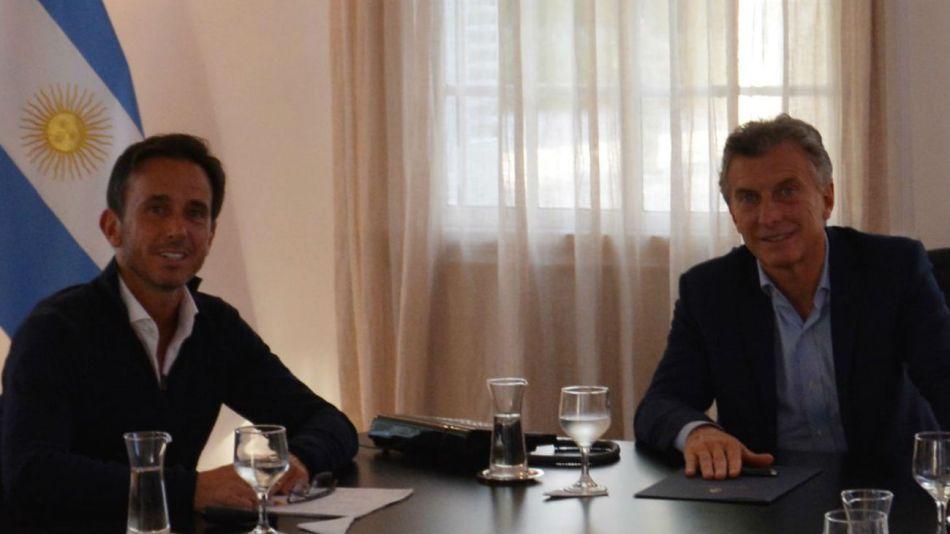 Sebastián Neuspiller, tiutlar de la SSS, junto al presidente Maurcio Macri