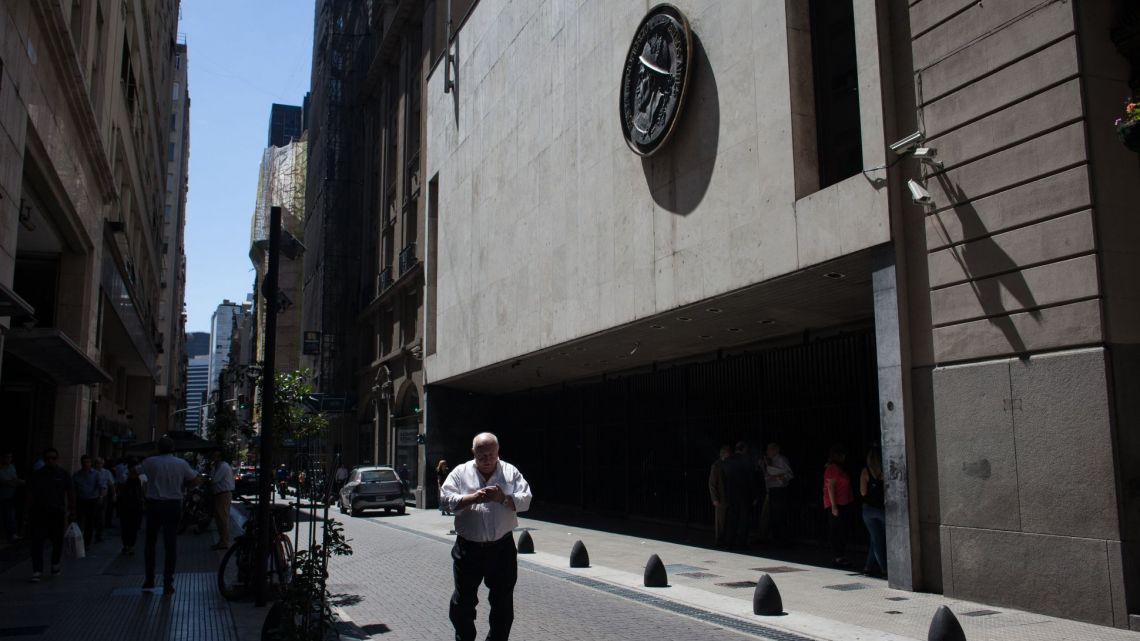 Pedestrians pass in front of the Buenos Aires Stock Exchange (BCBA) in Buenos Aires, Argentina.