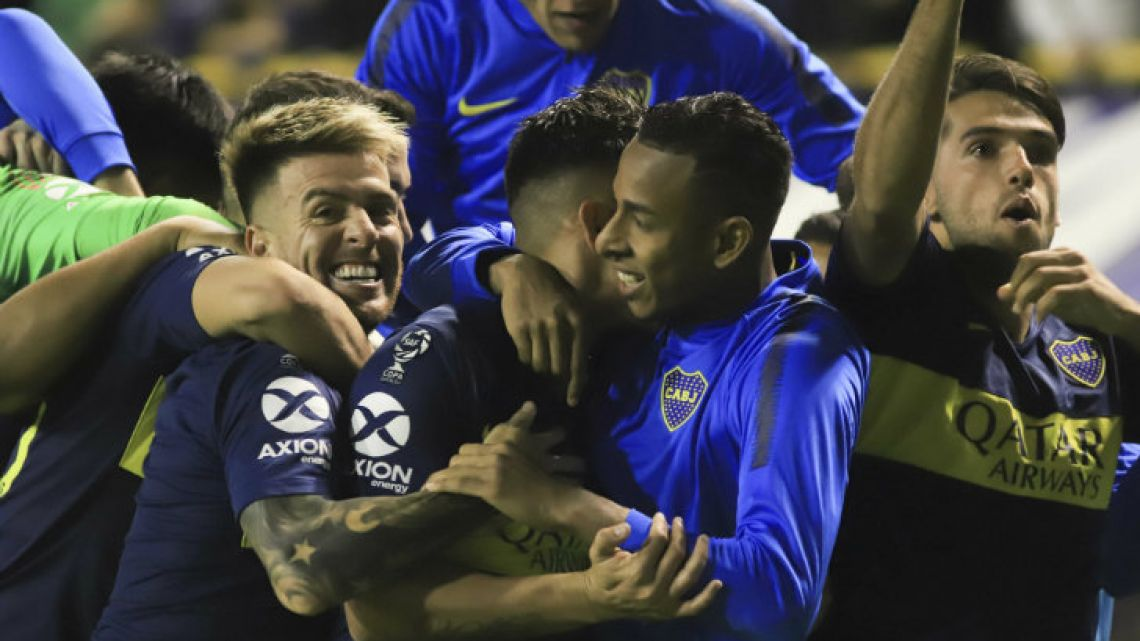 Boca Juniors players celebrate their victory over Vélez Sarsfield on penalty kicks.