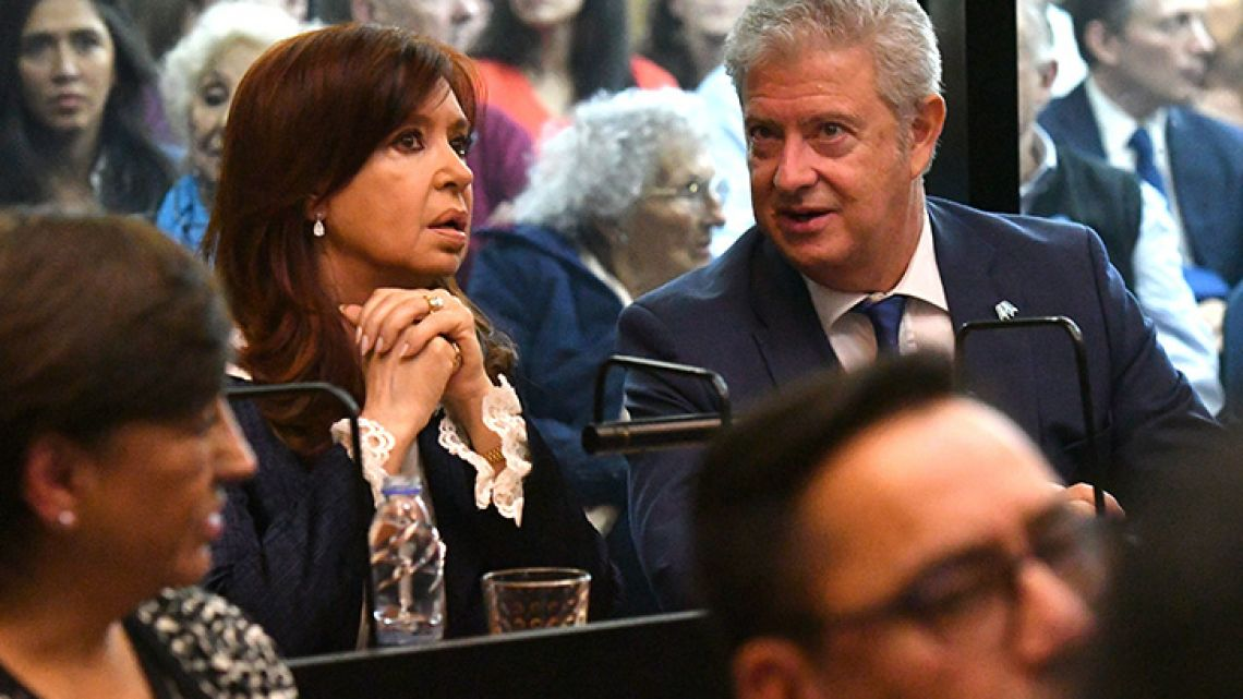 Former president Cristina Fernaández de Kirchner sits in court, as she awaits the beginning of proceedings.
