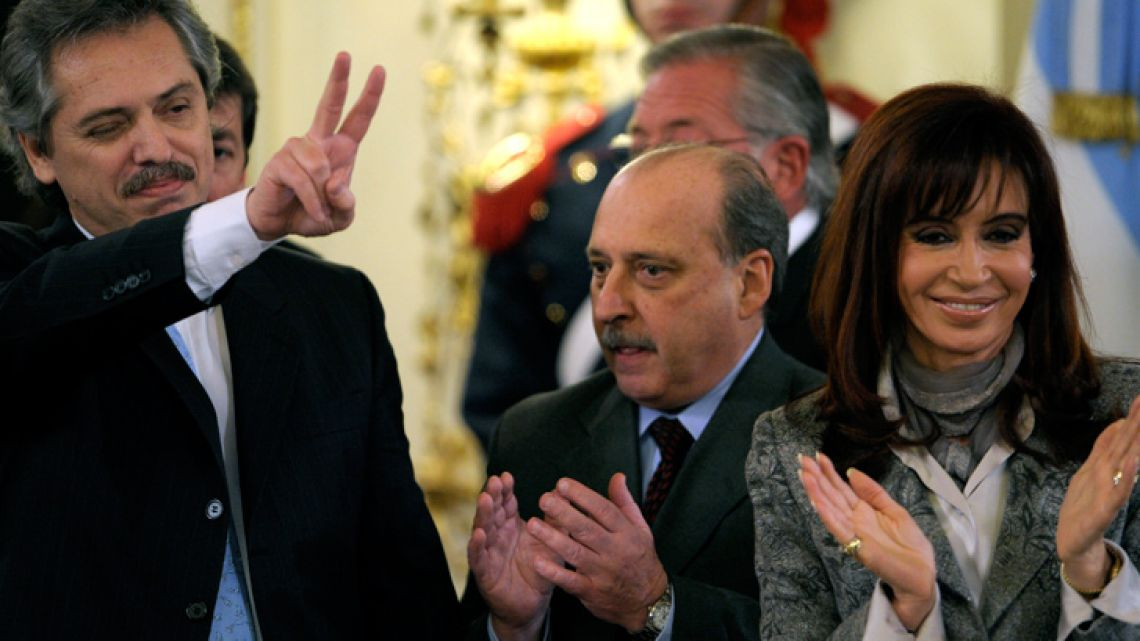 "Photo taken on July 24, 2008, shows then-outgoing Cabinet chief Alberto Fernández (left), flashing the ""V"" sign next to then-president Cristina Fernández de Kirchner."