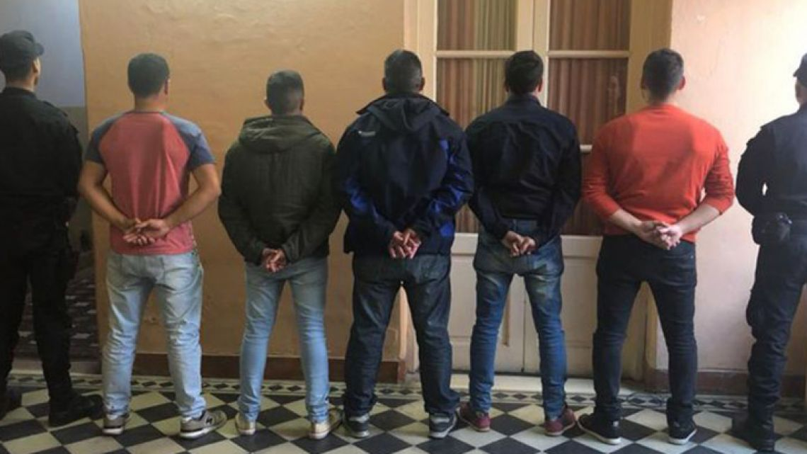 The seven arrested police officers, taking into custody in the wake of the fatal car chase in San Miguel del Monte.