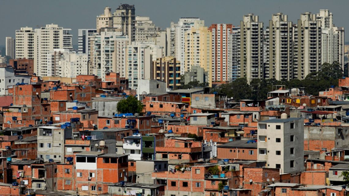 This May 22, 2019 photo shows brick and block brick houses of the sprawling slum neighbourhood of Paraisopolis, stacked next to the posh Morumbi neighbourhood, in São Paulo, Brazil. A study released this month by the Fundação Getúlio Vargas found that the key measure of income inequality has reached its highest level since the series began seven years ago, with Brazil among the most unequal nations in a broader region where the gap between rich and poor is notorious.