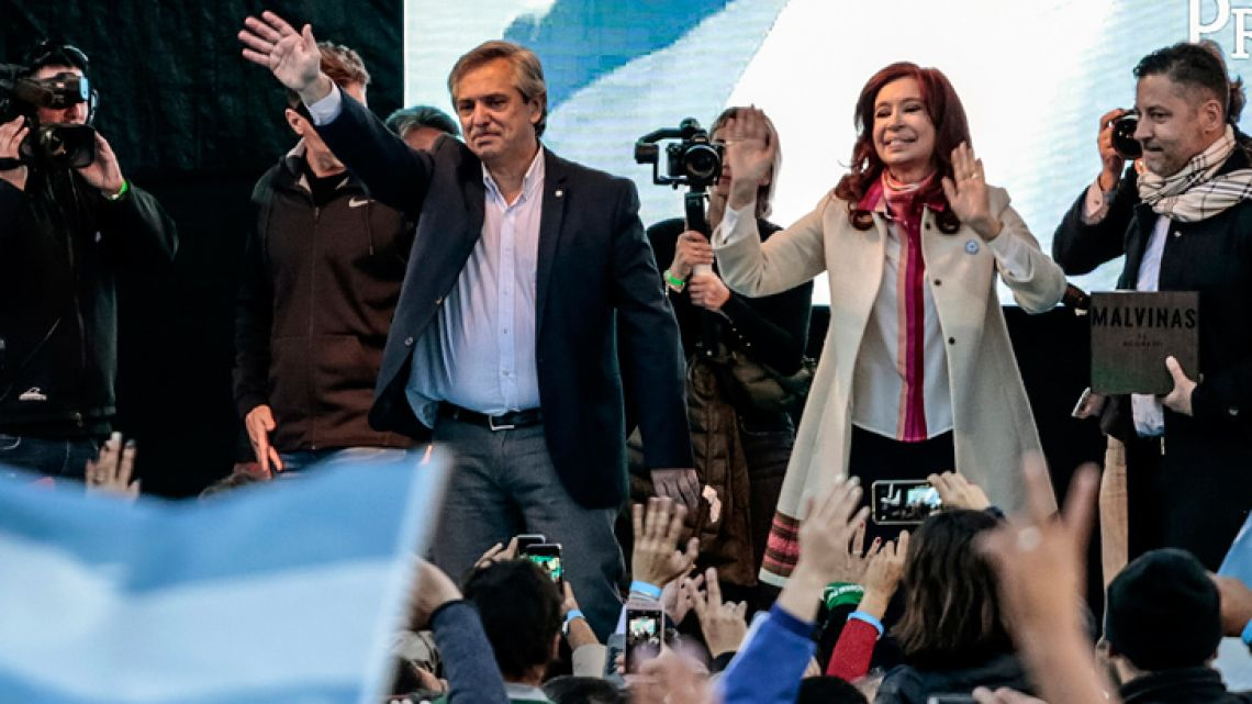Alberto Fernández and his running mate Cristina Fernández de Kirchner, wave to attendees during their first campaign event in Merlo, Argentina, on May 25.