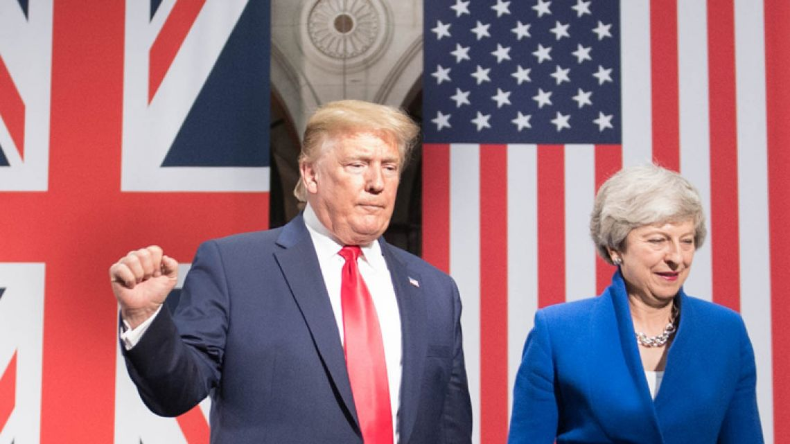 US President Donald Trump and Britain's Prime Minister Theresa May attend a joint press conference at the Foreign and Commonwealth office in London on June 4, 2019, on the second day of their three-day State Visit to the UK. US President Donald Trump turns from pomp and ceremony to politics and business on Tuesday as he meets Prime Minister Theresa May on the second day of a state visit expected to be accompanied by mass protests.