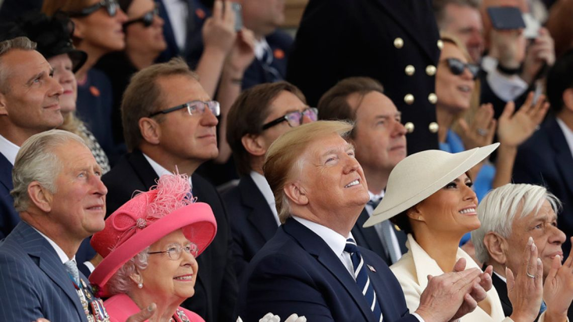 Britain's Prince Charles, Queen Elizabeth II, US President Donald Trump, First Lady Melania Trump and Greek President Prokopis Pavlopoulos, from left, applaud as they watch a fly past at the end of an event to mark the 75th anniversary of D-Day in Portsmouth, England Wednesday, June 5, 2019. World leaders including U.S. President Donald Trump are gathering Wednesday on the south coast of England to mark the 75th anniversary of the D-Day landings.