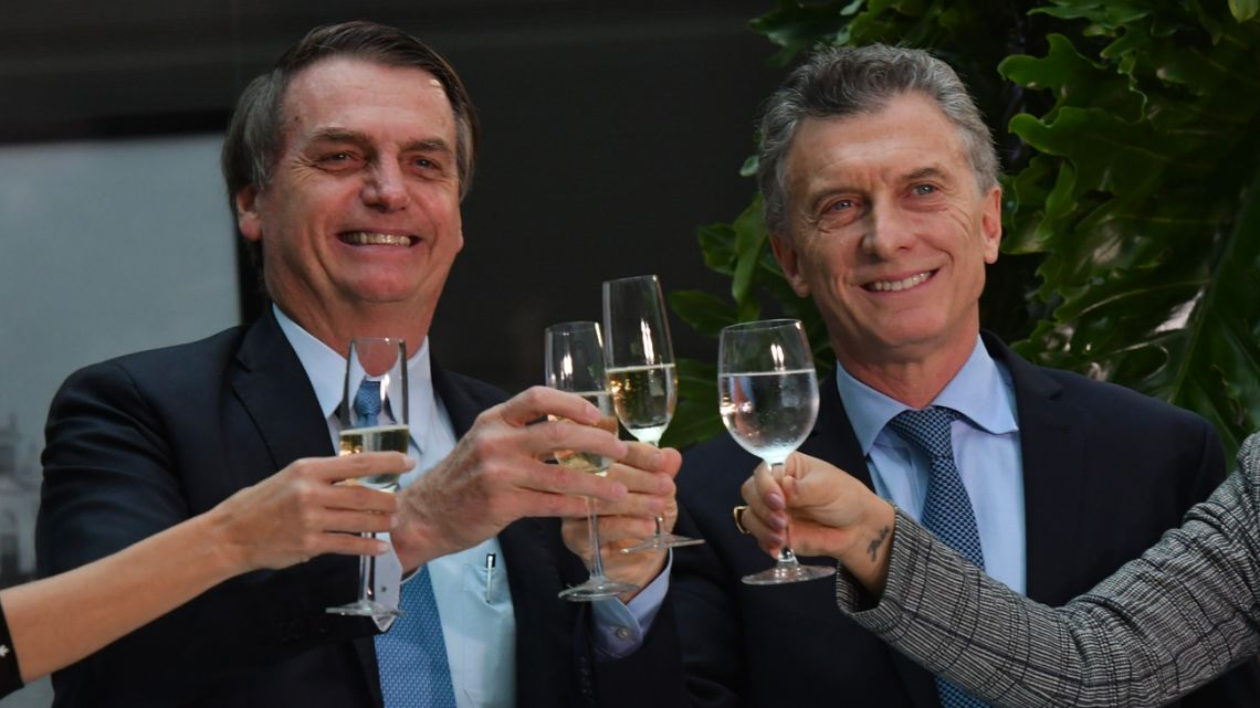 President Mauricio Macri (right) hosts his Brazilian counterpart Jair Bolsonaro (left) at the Casa Rosada.