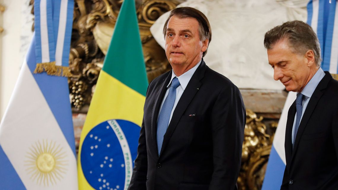 Brazil's President Jair Bolsonaro left, and President Mauricio Macri arrive to a press conference at the Casa Rosada in Buenos Aires on Thursday.