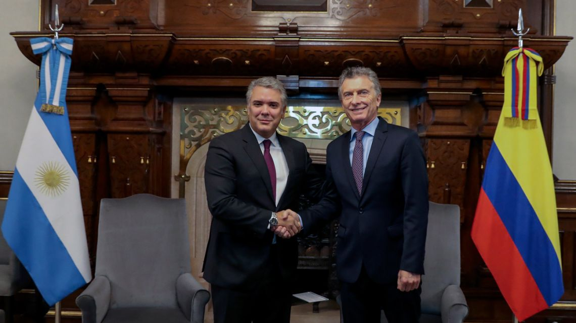 Handout picture released by the Presidency shows President Mauricio Macri (right) shaking hands with his Colombian counterpart Iván Duque during a meeting at the Casa Rosada.