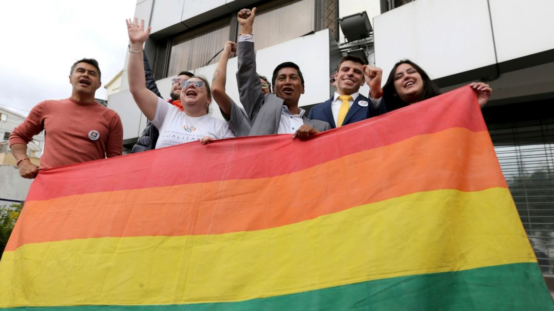 Activists celebrate the legalization of sam-sex marriage outside Ecuador's Constitutional Court in Quito.