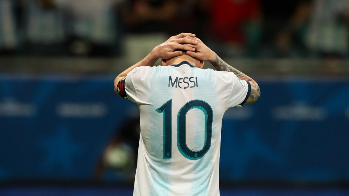 Argentina's Lionel Messi gestures after failing to score during a Copa America Group B soccer match against Colombia