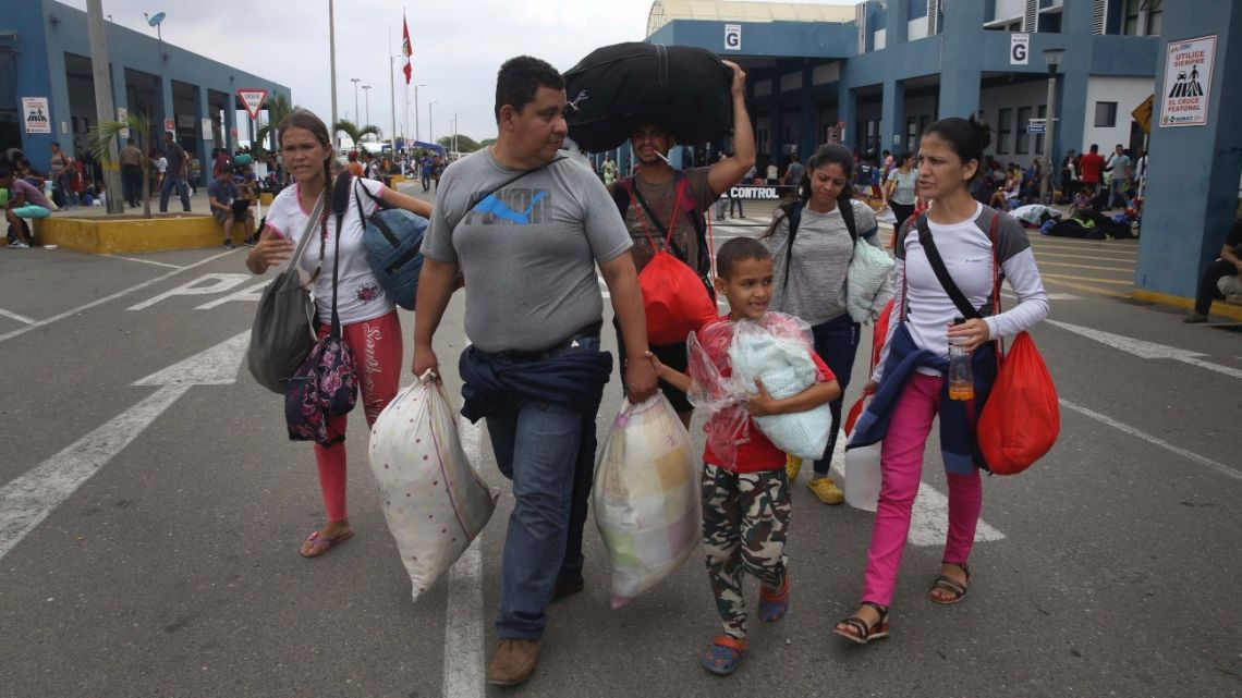 Venezuelan refugees reach a border crossing in Tumbes on the Peruvian side of the border with Ecuador.