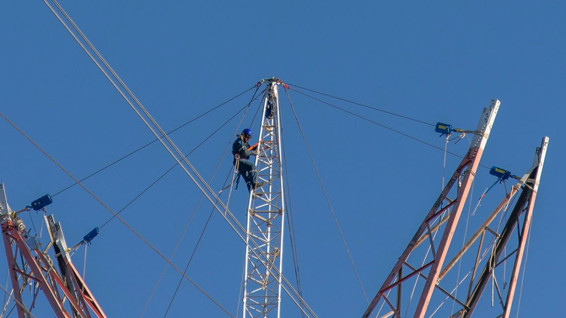 A technician works to continue dismantling Tower 412 and replace it with a new tower, in the Litoral corredor near the town of Zarate.