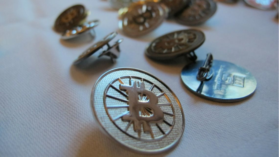 Bitcoin buttons are displayed on a table at the Inside Bitcoins conference in Berlin Feb. 12, 2014.
