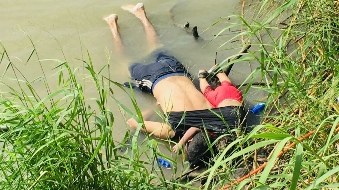 The bodies of Salvadoran migrant Oscar Alberto Martínez Ramírez and his nearly 2-year-old daughter Valeria lie on the bank of the Rio Grande in Matamoros, Mexico, Monday, June 24, 2019.
