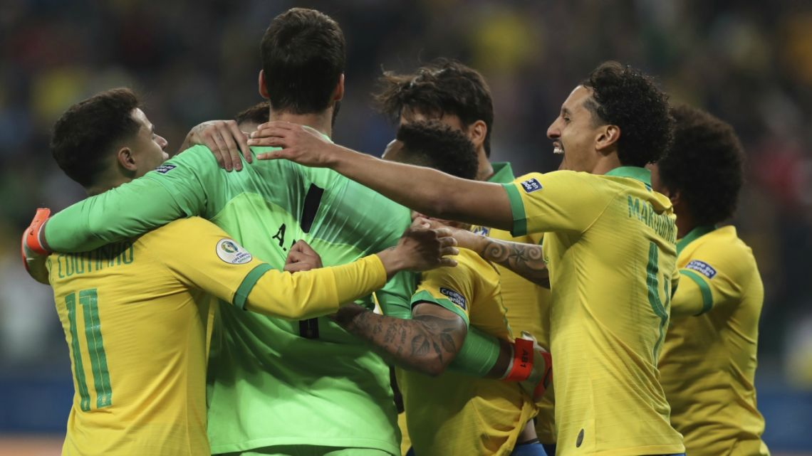 Brazil's players celebrate after winning the penalty shoot-out against Paraguay.