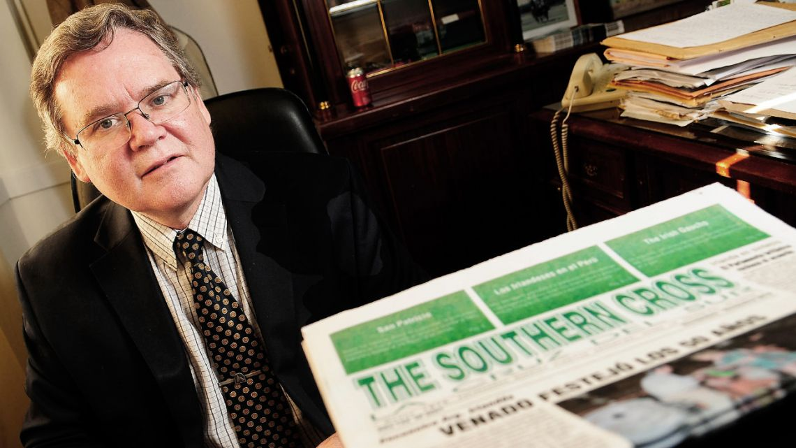 Guillermo MacLoughlin poses with a The Southern Cross print edition.
