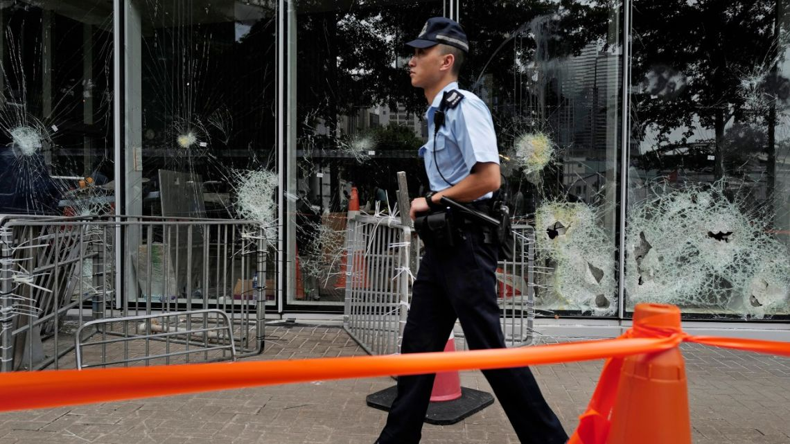 A police officer patrols outside Legislative Council building in Hong Kong, Tuesday, July 2, 2019.