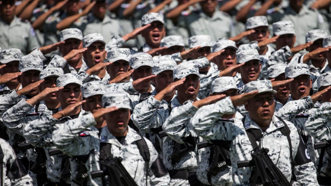 National Guard soldiers salute as the new force is presented during a ceremony at a military field in Mexico City.