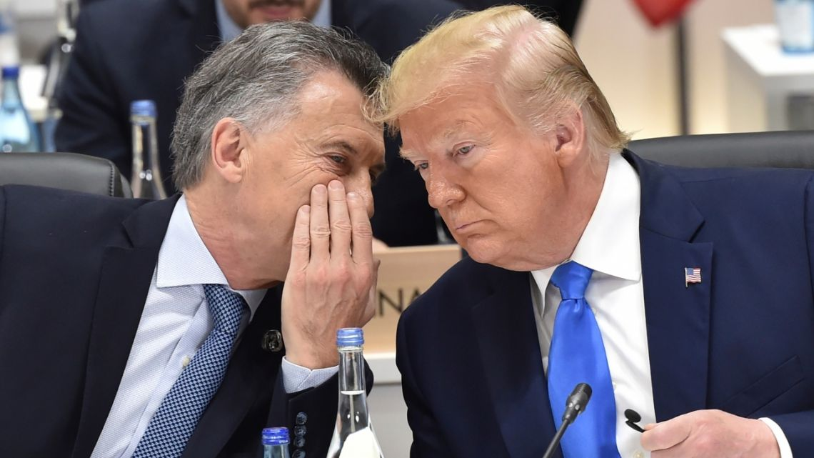Mauricio Macri talks with US President Donald Trump at the G20 Summit in Osaka Saturday, June 29, 2019