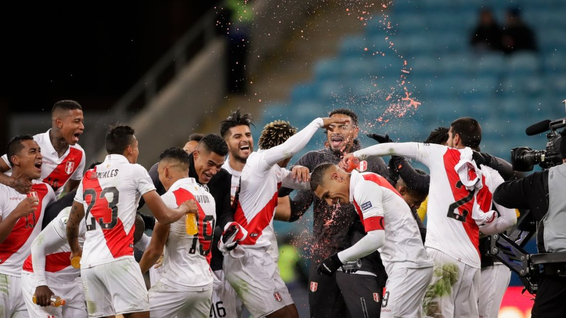 Peru's players celebrates their side's win over Chile during a Copa América semifinal soccer match in Porto Alegre, Brazil, Wednesday, July 3, 2019.