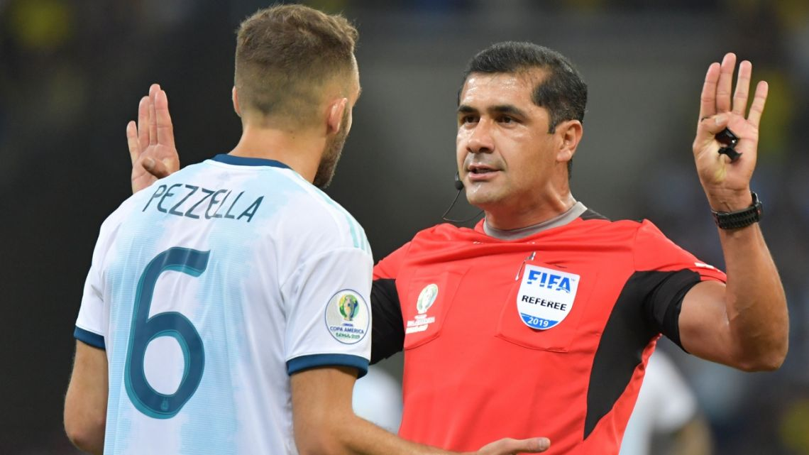 Ecuadorean referee Roddy Zambrano gestutes at Argentina's German Pezzella at the semifinal match between Brazil and Argentina in Belo Horizonte, Brazil, on July 2, 2019.
