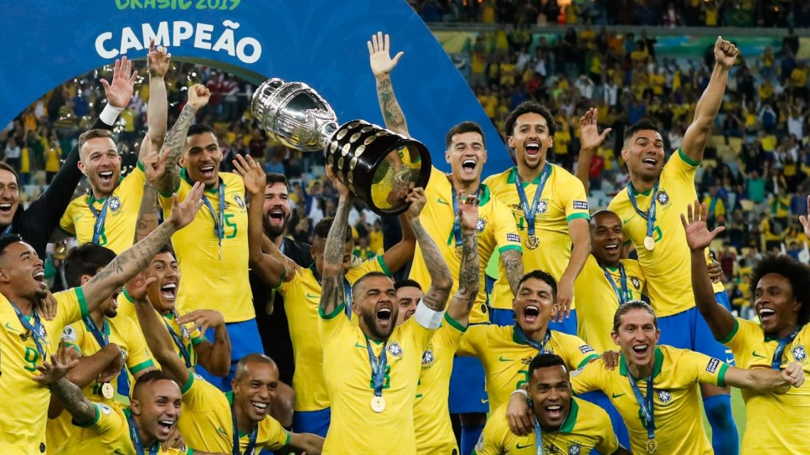 Brazil's Dani Alves lifts up his team's trophy after winning the final match of the Copa America against Peru in Rio de Janeiro, Brazil, Sunday, July 7, 2019.