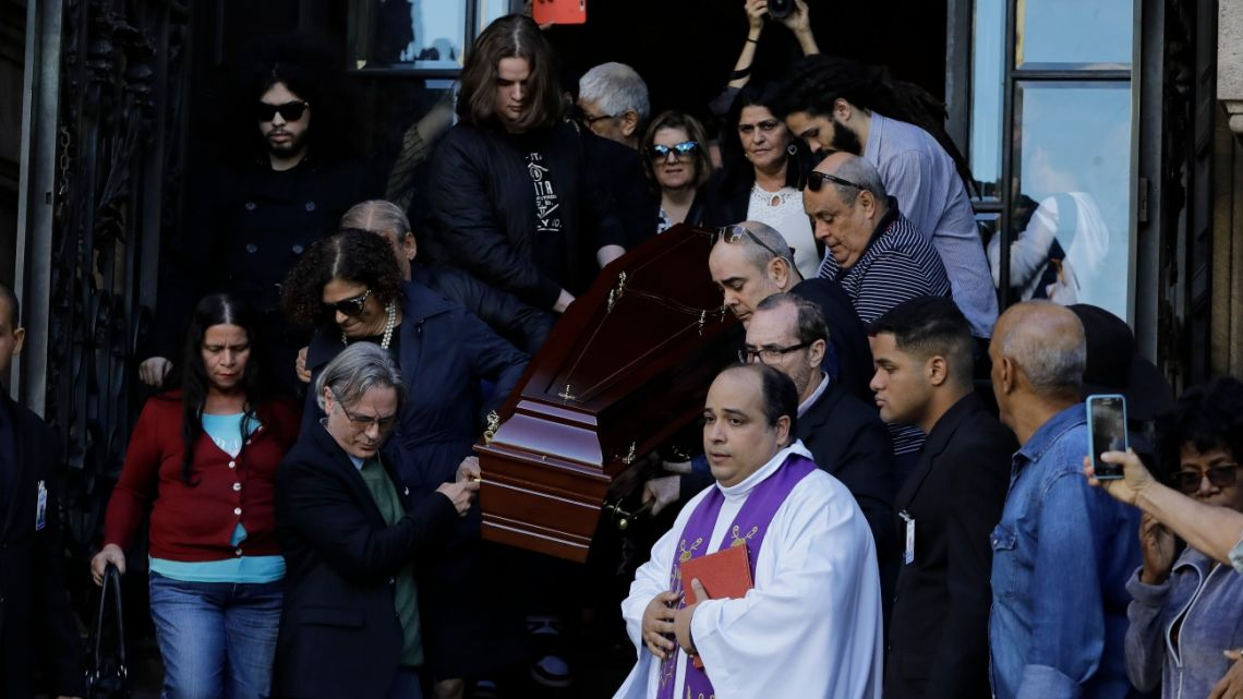 Relatives and friends carry the coffin of Brazilian cultural icon Joao Gilberto out of the Municipal Theater where his wake was held in Rio de Janeiro, Brazil, Monday, July 8, 2019.