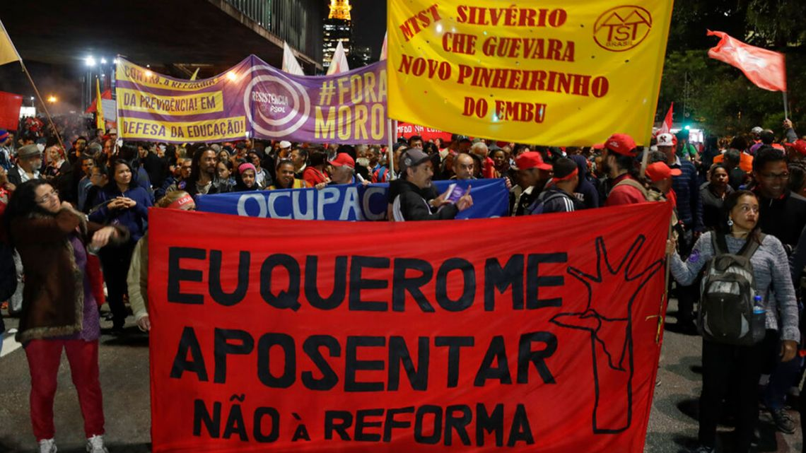 "Demonstrators hold banner saying ""I want to retire, no to the pension reforms"", during a protest against the pension reforms in Sao Paulo, Brazil,"