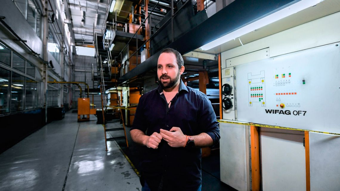 General Manager of Venezuelan newspaper El Nacional, Jorge Makriniotis, speaks pictured by the company's printing press in Caracas. Due to the shortage of paper and scarce personnel, many Venezuelan outlets are relying on the Internet as a way to survive.