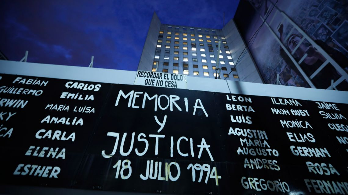 A sign that reads in Spanish 'Memory and Justice: 18 July 1994' and the names of those who died during the bombing of the AMIA Jewish community centre, is displayed outside the site of the attack on the 25th anniversary of the bombing.