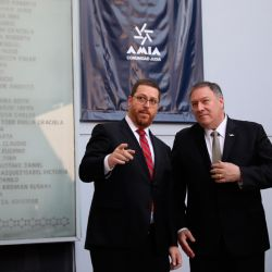 AMIA Acting President Ariel Eichbaum, US Secretary of State Mike Pompeo and Foreign Minister Jorge Faurie attend a memorial service to honour the 85 people who died in the AMIA bombing, in Buenos Aires, Argentina, Friday, July 19, 2019.