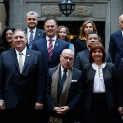 US Secretary of State Mike Pompeo, second from left, and Foreign Minister Jorge Faurie and Security Minister Patricia Bullrich, pose for a group photo with foreign ministers and representatives from 18 countries in the hemisphere, during a counterterrorism conference at the Palacio San Martín in Buenos Aires.