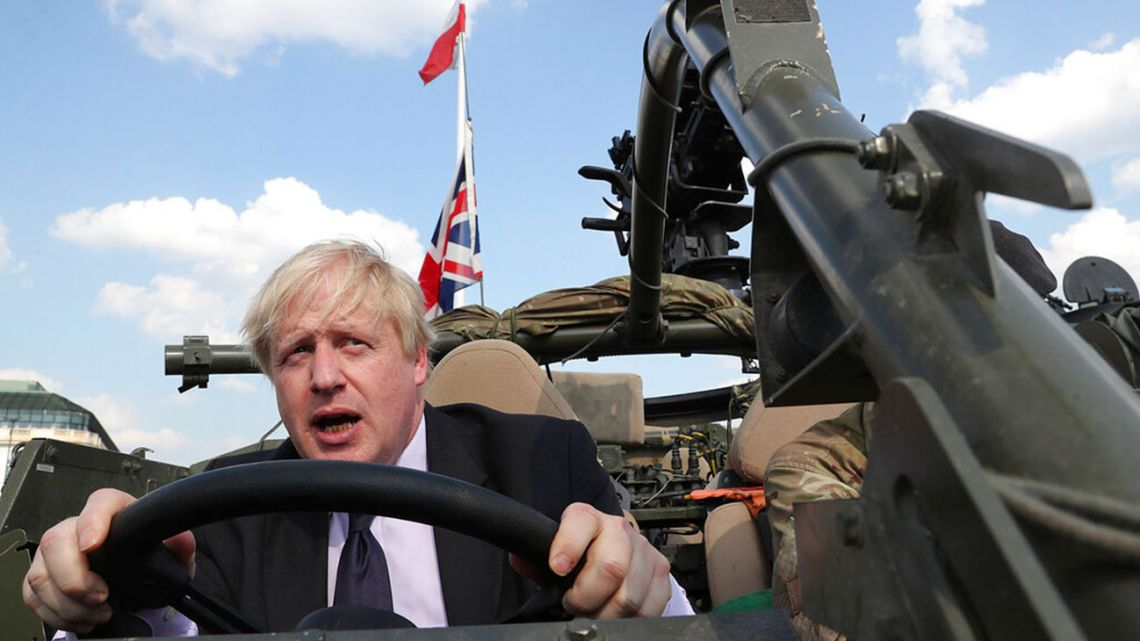 UK PM-to-be Boris Johnson drives military vehicle in Orzysz, Poland