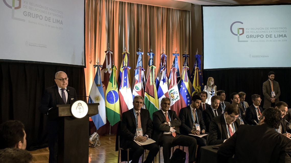Handout photo released by the Foreign Ministry shows Foreign Minister Jorge Faurie (left) speaking during a meeting of the Lima Group in Buenos Aires on July 23, 2019.