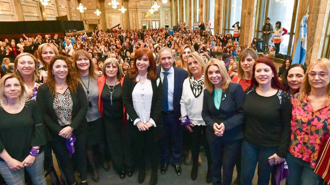Cristina Fernández de Kirchner poses for a picture with female banking workers at an event in Buenos Aires in July 2019.