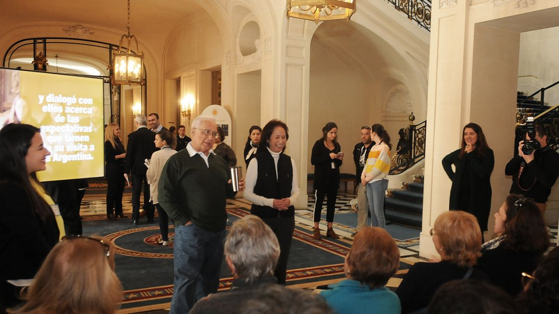 US Ambassador to Argentina Edward Prado talks to guests, as they enjoy a tour of Palacio Bosch.